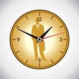 大黄色壁钟和商人 免版税图库摄影
