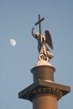 天使包括月亮雪 免版税库存照片