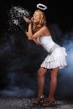 天使吹动女孩好的雪 免版税库存照片