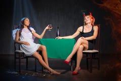天使和恶魔用白兰地酒 图库摄影