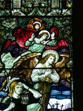 天使和污迹玻璃窗的罗马战士 库存照片