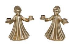 以天使形象的形式古铜色烛台 免版税库存照片