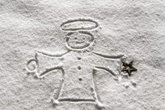 天使接近的雪 免版税库存照片