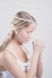 天使祷告 库存图片