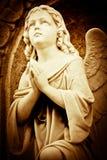 天使美好的图象祈祷的葡萄酒 库存照片