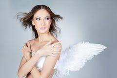 天使背景美好的典雅的女孩灰色 图库摄影