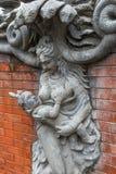 天使雕塑和雕刻雕象  神话和腿生物  库存图片