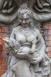 天使雕塑和雕刻雕象  神话和腿生物  免版税图库摄影