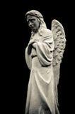 天使黑色哭泣的查出的雕象 库存图片