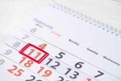 天冬季体育 在日历的2月11日马克 免版税库存图片