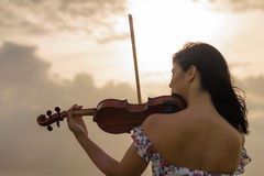 天堂般的小提琴手 库存图片