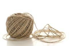 天然纤维在白色的麻线字符串短管轴  免版税库存图片