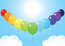 天空气球彩虹云彩领导 免版税图库摄影
