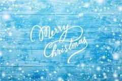 天蓝色的木背景 对题字和愿望,浅兰,海 雪花作用 并且圣诞快乐题字 图库摄影
