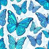 天蓝色的蝴蝶无缝的背景 免版税图库摄影