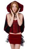 天鹅绒bordo礼服的俏丽的夫人有盖帽的 免版税库存图片