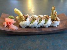 天麸罗芦笋在木板材的寿司卷 免版税库存图片