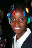 年轻天主教学校女孩是在乡村诊所的所有微笑 免版税库存照片