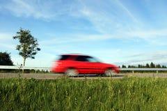 太快速驾驶乘在路的汽车 库存图片