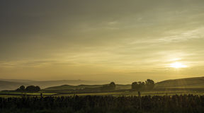 太阳上升在高峰区 免版税图库摄影