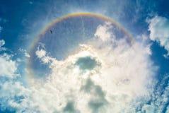 太阳光晕和云彩 库存图片