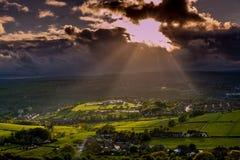太阳发生云彩 图库摄影