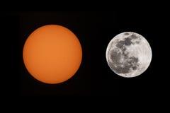 太阳和月亮 射击在黑色 免版税库存图片