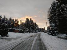 太阳填装了雪云彩 库存照片