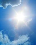 太阳火光和云彩 免版税图库摄影