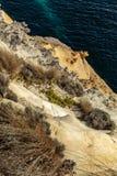 太阳点燃了砂岩反对海洋在耶稣十二门徒,大洋路,维多利亚,澳大利亚 免版税库存照片