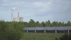 太阳电池板和常规能源厂 影视素材