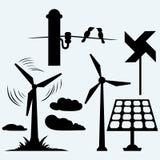 太阳电池板和风车,在杆的导线 免版税库存照片