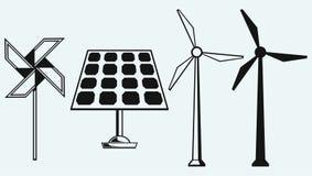 太阳电池板和风车 库存照片
