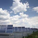 太阳电池板和风车 免版税库存图片