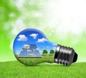 太阳电池板和风轮机在电灯泡 免版税库存照片