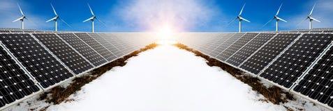 太阳电池板和风turbins照片拼贴画在与雪的冬天 免版税库存图片