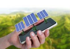 太阳电池板在手边与后边山 库存照片