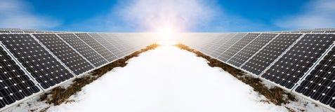 太阳电池板照片拼贴画在与雪的冬天 库存照片