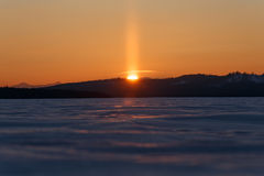 太阳的前个片断在日落的 Lightcolumn 免版税图库摄影