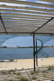从太阳的风雨棚在海滩 库存图片