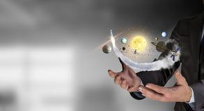 太阳系在手上 免版税库存图片