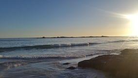 太阳落下和光束  免版税图库摄影