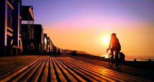 太阳道路骑自行车者 库存图片