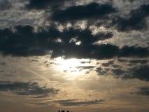 太阳采取了面具 免版税库存照片