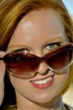太阳镜的妇女 图库摄影