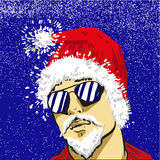 太阳镜的年轻圣诞老人导航基督,如同说明 免版税库存图片