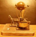 太阳系仪Steampunk有木星和4月亮的艺术时钟 库存图片