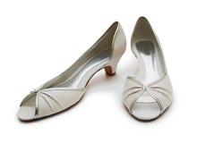 夫人对s穿上鞋子白色 免版税库存照片