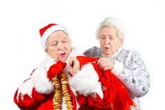 夫人未婚老圣诞老人雪 库存图片