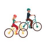 年轻夫妇、男人和妇女,乘坐的自行车,循环在盔甲 免版税图库摄影